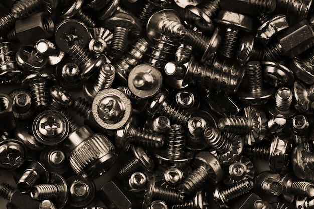 Dark tone of bolts and nuts screws texture background