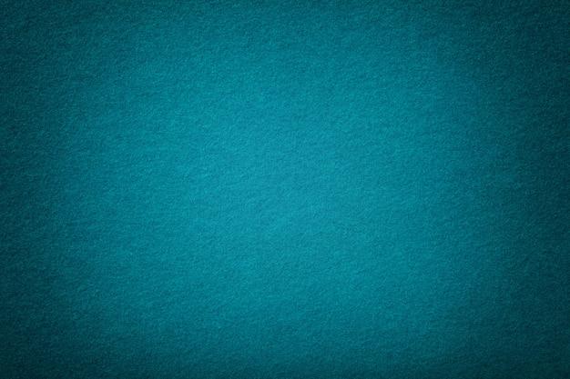 Dark turquoise matt suede fabric  velvet texture of felt,