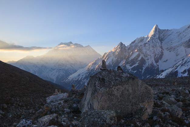 Dark valley and snow peak of samdo shot from high larke pass  just before sunrise