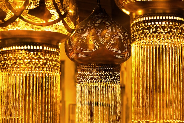 Dark vintage oriental hanging lamps in a golden glow.