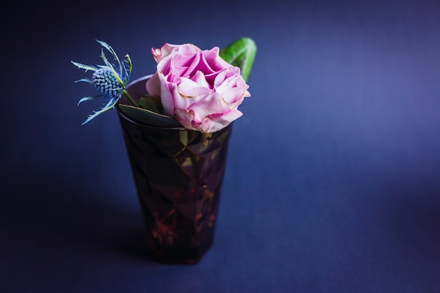 Dark violet glass with pink rose and blue cone