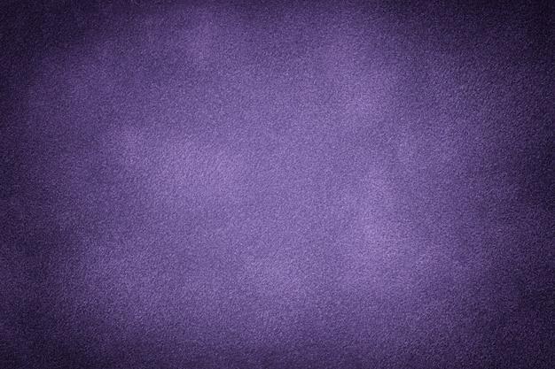 Dark violet matte background of suede fabric