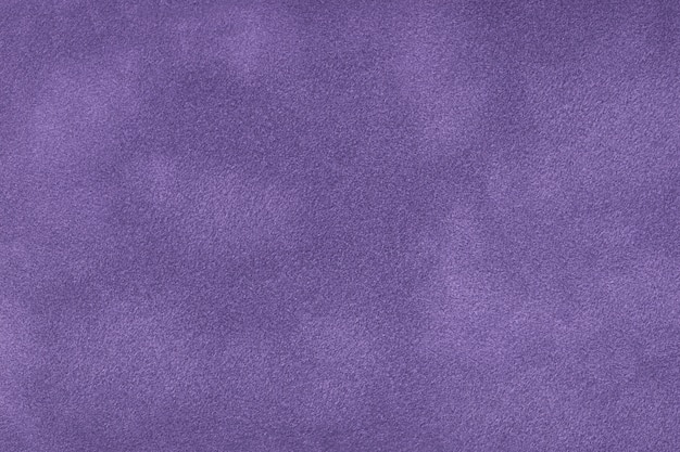 Dark violet matte background of suede fabric