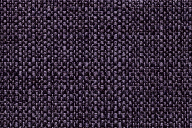 Dark violet textile background with checkered pattern, closeup. structure of the fabric macro.