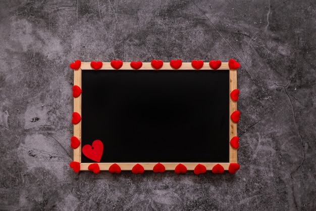 Dark with red and white hearts and a black board for a valentine's day