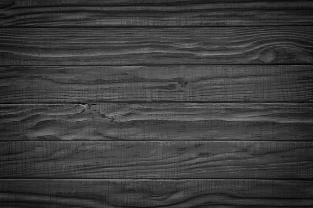 ダークウッド。黒の素朴な木製テーブルの背景上面図
