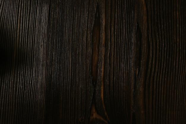 Темная текстура древесины фон окрашена широкая доска