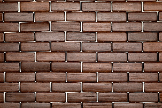 Dark wood texture in the shape of small rectangles like bricks (collection of natural and vegetal fibers).
