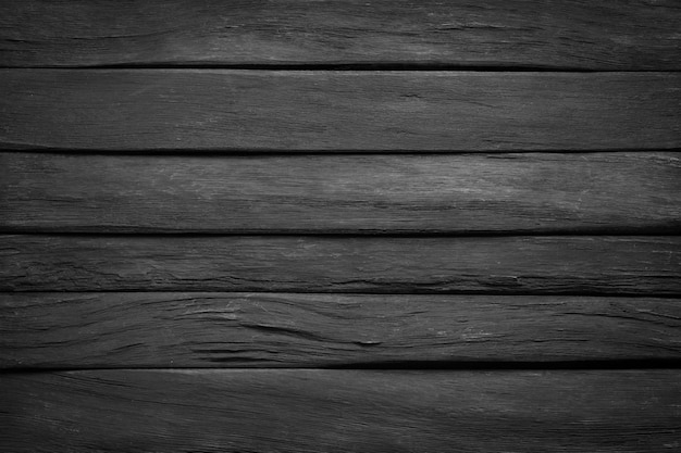 Dark wood texture, top view. black wall boards as background