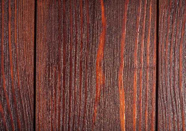 Темный деревянный фон, покрытый лаком и морилкой