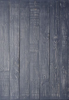 Dark wooden background made of a narrow board, painted in dark gray.