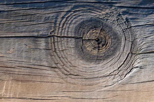 暗い背景の木のテクスチャ。古いフェンスパネル