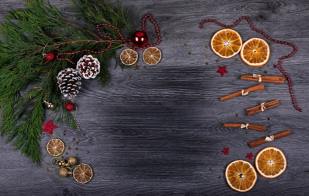 A dark wooden background with christmas decor and copy space for text
