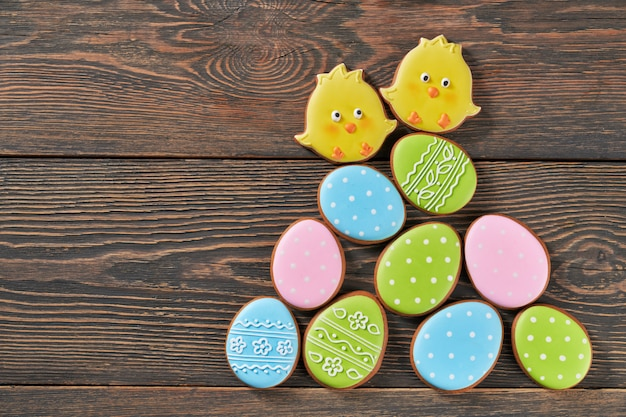 Dark wooden background with delicious easter gingerbread