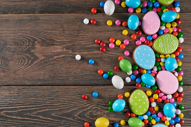 Dark wooden background with easter candies and gingerbread