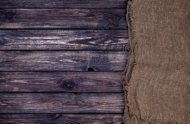 黄麻布、木材、袋で暗い木製のテクスチャ