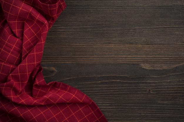 Dark wooden wallwith red napkin
