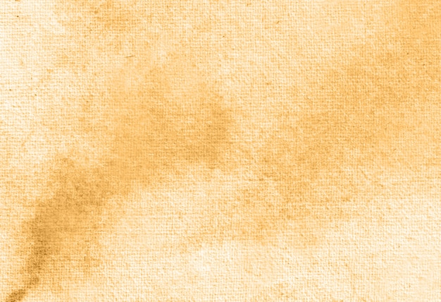 Dark yellow abstract pastel watercolor hand painted background texture.