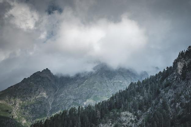 Darkly rocks and clouds. caucasus, dombai, karachay-cherkessia