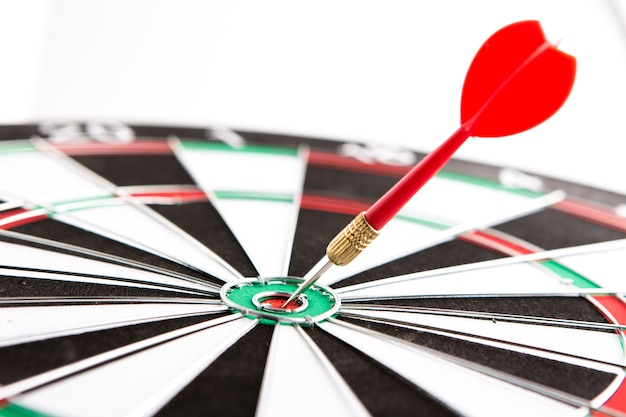 Dart arrow hitting in the target center, concept of personal coaching success