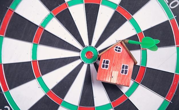 Dart arrow, house model on dartboard.