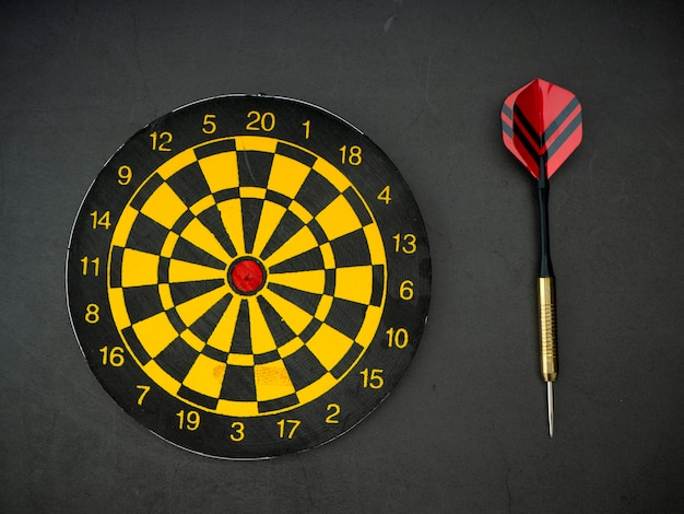 Dart arrow with board on black granite