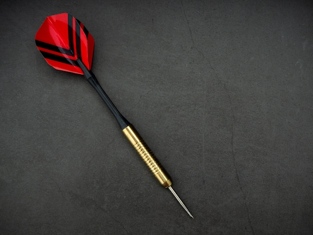Dart arrow with board on black granite