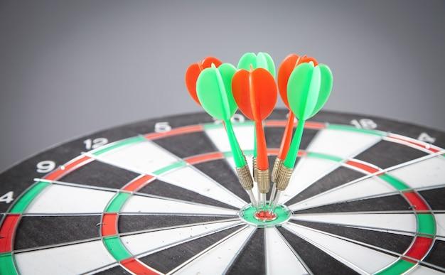 Dart arrows in the dartboard. success