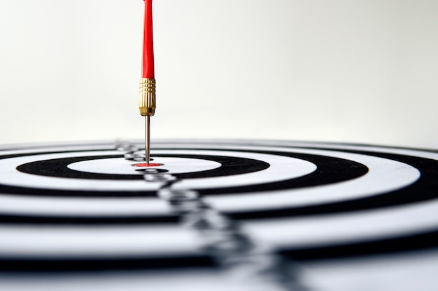 Dart hit target close-up. well aimed hit. winning the competition. success in business. achievement in life. go to its goal. achieve the goals. the game of darts. sports target. targeted advertising