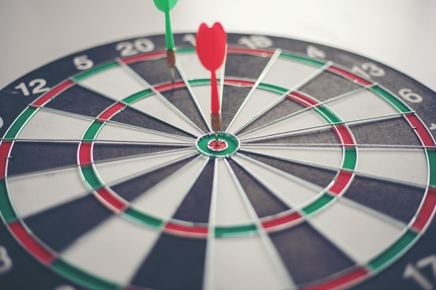 Dart hits bullseye is a target and goal of business marketing as concept.