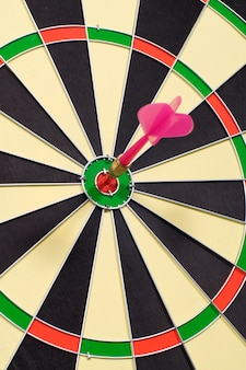 Dart hitting a target on circular dart board