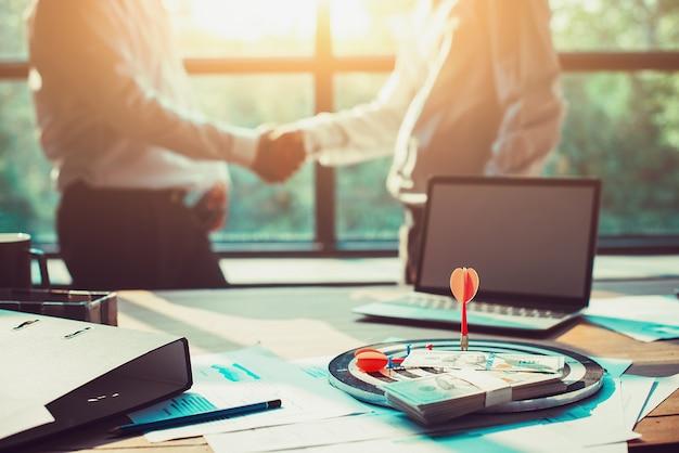 Dart port to center of target on the desk like success business. - image