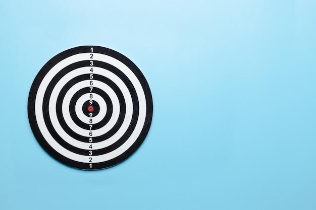 Dart target board on blue background