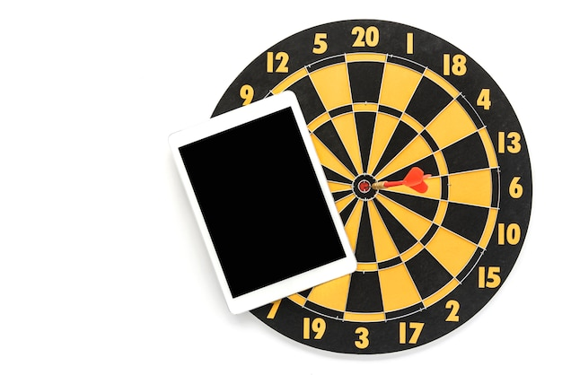 Dart target on bullseye with blank black screen tablet