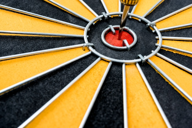 Dart target with arrow on the center of dartboard