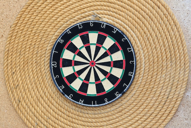 Dartboard against rope background