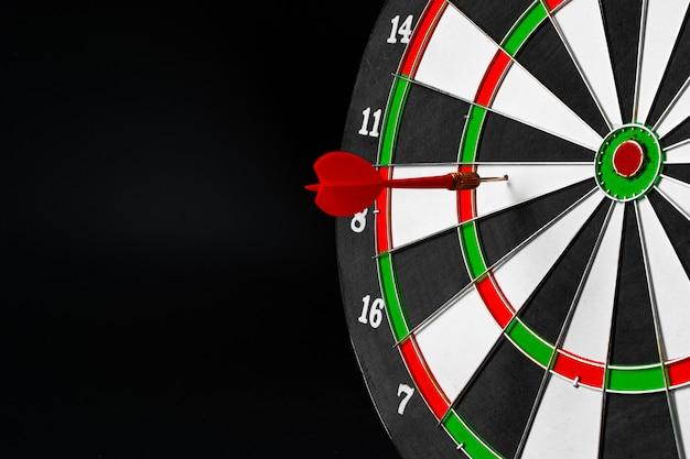 Dartboard on black dark background close up. aiming concept