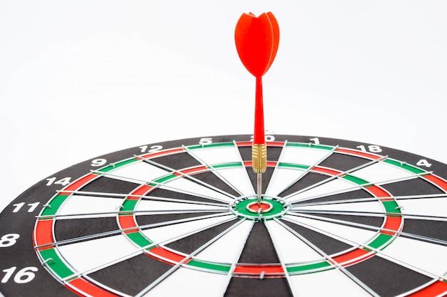 Dartboard with red dart arrow on white
