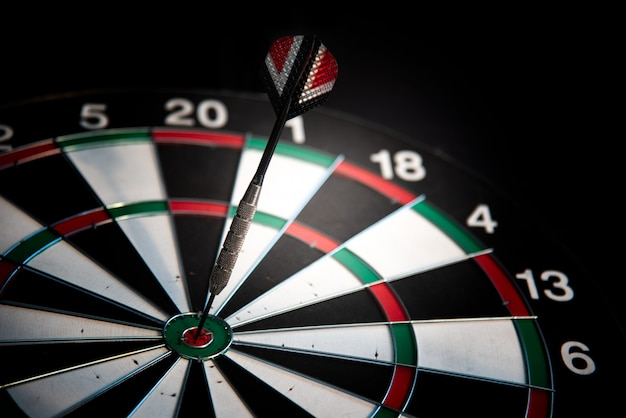 Darts arrows in center target. many attempts to succeed concept