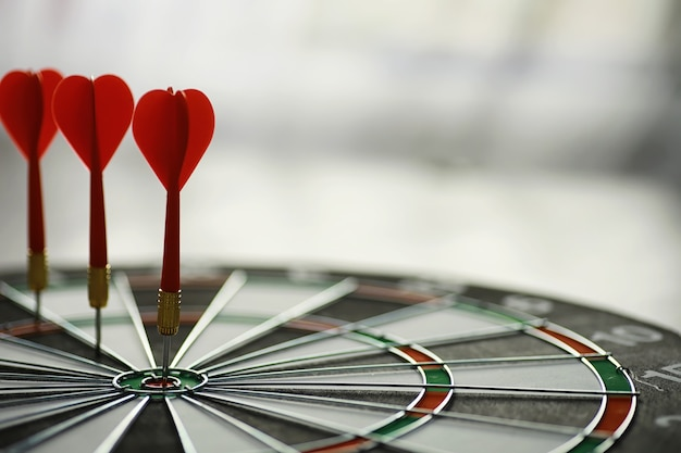 Darts. the dart for playing in the game board is stuck. hit the sector in darts. the concept of a successful strategy.