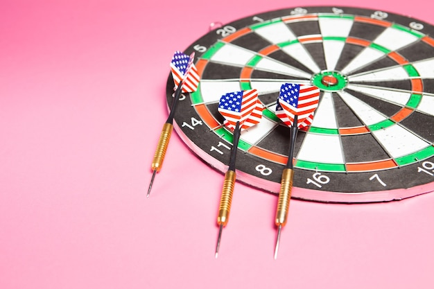 Darts and darts on pink. goal concept