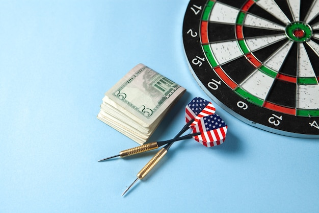 Darts and money on the table