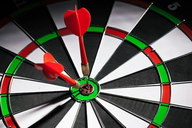 Darts stuck in dartboard