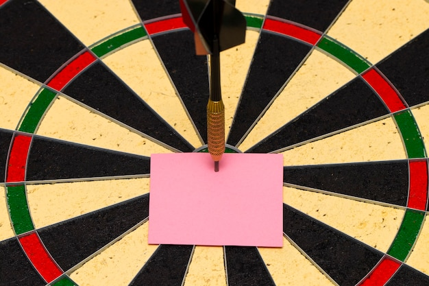 Darts with dart arrow which was pinned a sheet of paper for labels