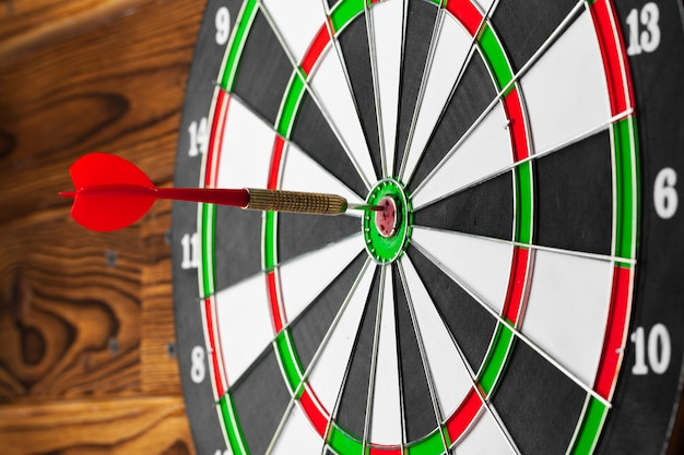 The darts on wooden background