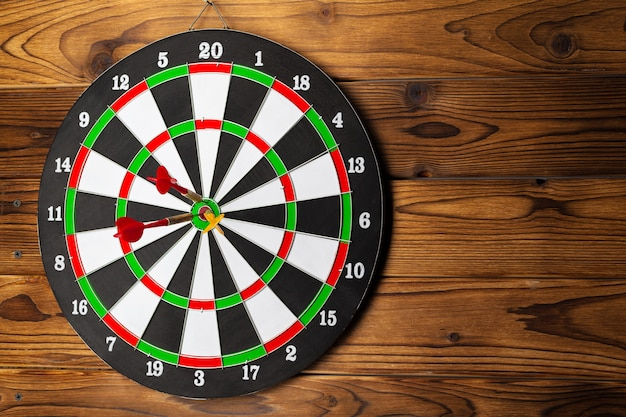 The darts on wooden wall