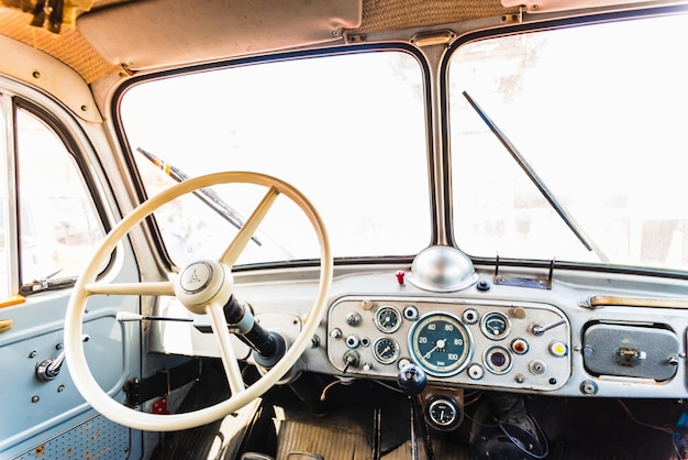 Dashboard and steering wheel of an old retro american van still in use.