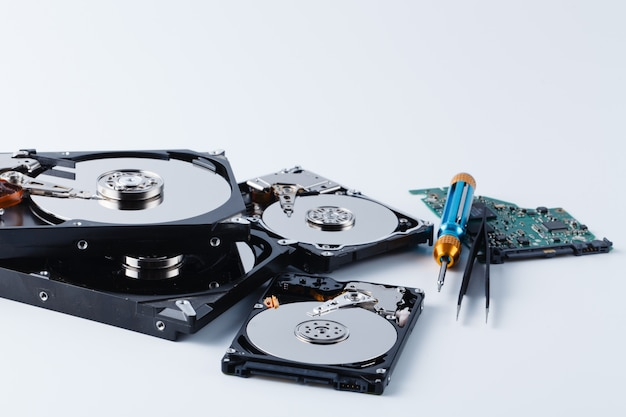 Data repair concept, open hard drive with tools
