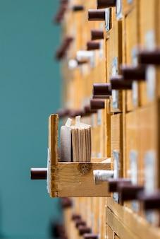 Database concept. vintage cabinet. library card or file catalog.