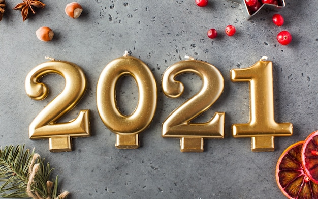 Date 2021 in the form of golden candles